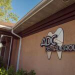 Outside front view of the dental office displaying logo.